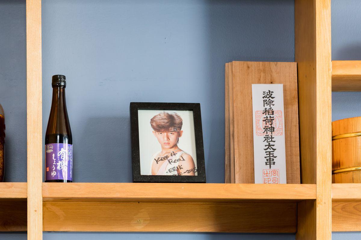 A framed photo behind the sushi bar at Chisai Sushi Club.
