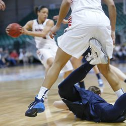 Brigham Young Cougars guard Lexi Eaton (21) falls under Gonzaga Bulldogs guard Jazmine Redmon (34) during the West Coast Conference championship game in Las Vegas Tuesday, March 11, 2014. BYU lost 71-57.