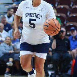 Maria Conlon brings the ball up the court.