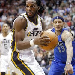 Utah Jazz forward DeMarre Carroll (3) spins after getting a rebound as the Utah Jazz and the Dallas Mavericks play Monday, April 16, 2012 in Salt Lake City.