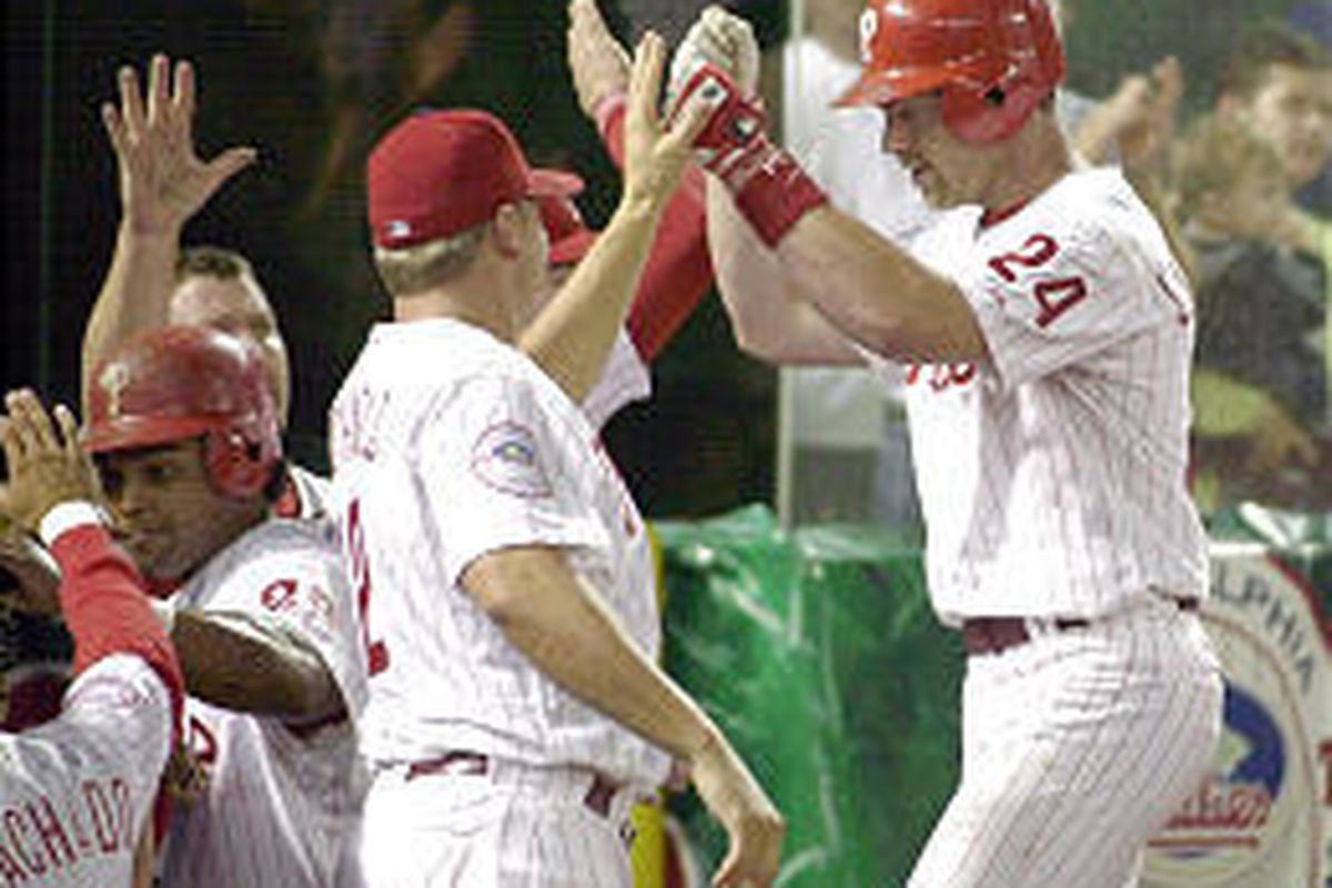 Phillies' Mike Lieberthal, right, is congratulated after hitting a three-run HR against the Cincinnati Reds.