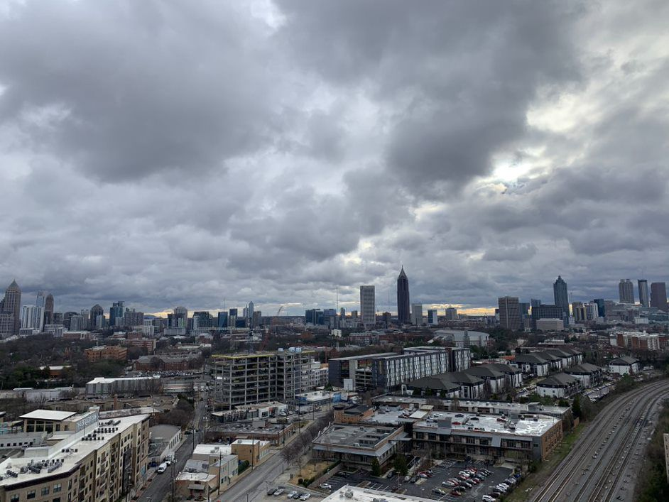 A lot of building and a city skyline under gray skies.