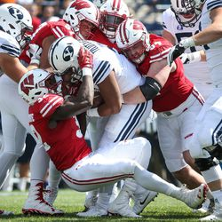Brigham Young Cougars running back Ula Tolutau (5) is taken down by Wisconsin Badgers linebacker Leon Jacobs (32) and other defensive players at LaVell Edwards Stadium in Provo on Saturday, Sept. 16, 2017.