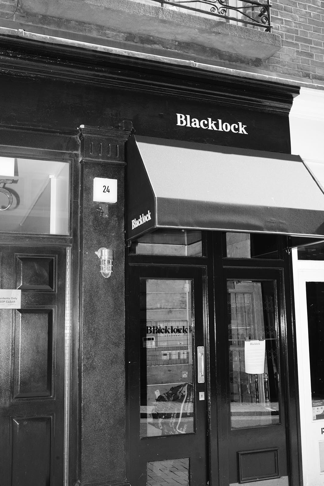 Blacklock steakhouse in Soho with a closure notice in its front door