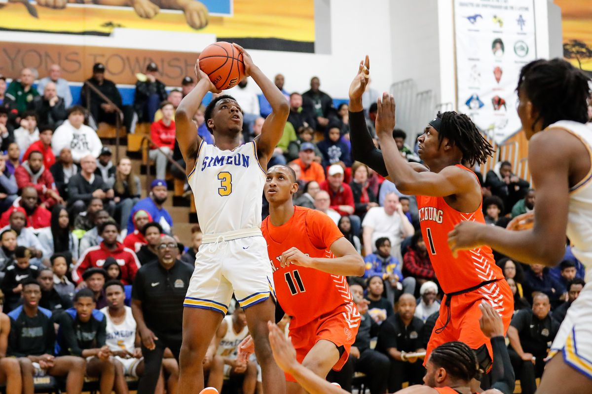 Simeon's Jeremiah Williams (3) shoots the ball over Young.