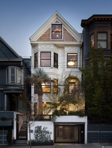 A San Francisco house with a brown brick facade and painted white details.