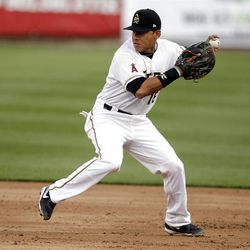Salt Lake Bees' Efren Navarro, here in action in Friday night's game, was honored Saturday with a Gold Glove award.  recognizin throws a runner out at second as the Salt Lake Bees open the season at home  in Salt Lake City  Friday, April 13, 2012.2012.