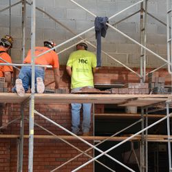 5:12 p.m. Bricklayers at work on the Sheffield wall -