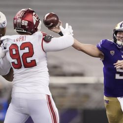 Washington quarterback Dylan Morris, right, passes under pressure from Utah defensive end Maxs Tupai (92) during the first half of an NCAA college football game, Saturday, Nov. 28, 2020, in Seattle.