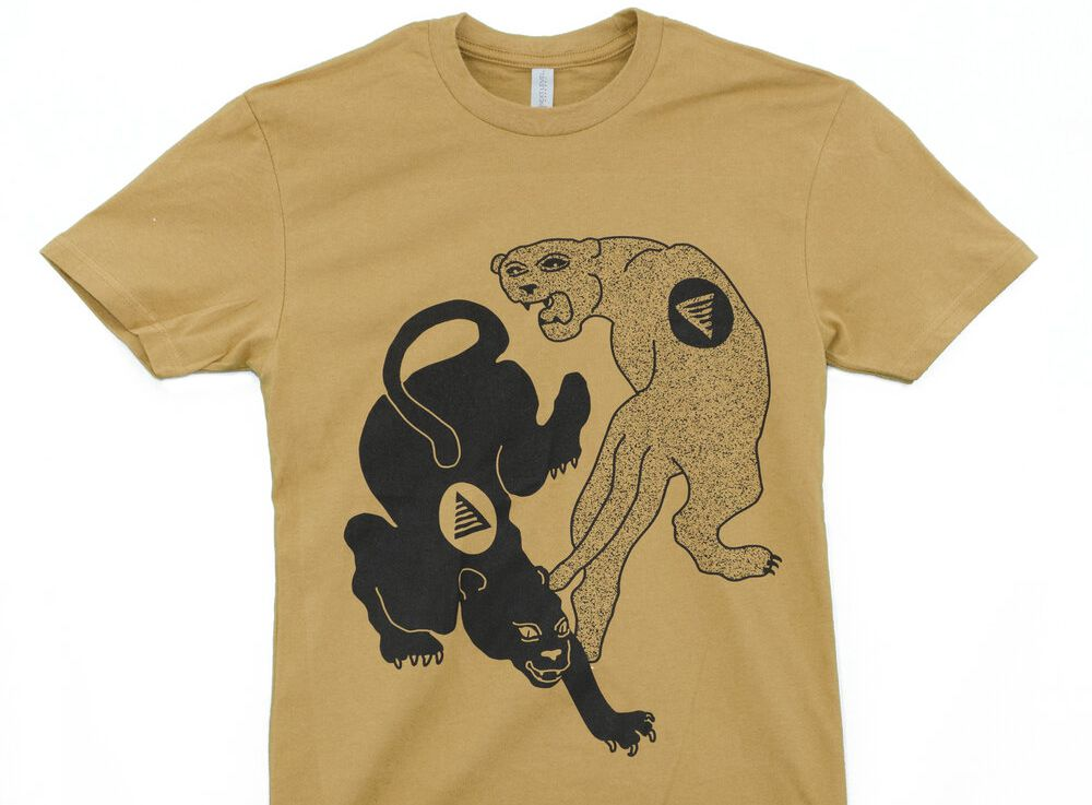 A gold shirt with two snarling panthers on it.