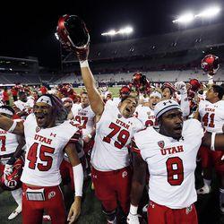 Utah football players celebrate after defeating Arizona in Tucson, Arizona, on Friday, Sept. 22, 2017. Utah beat Arizona 30-24.