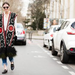 A feather-trimmed vest and Gucci loafers spotted on the streets of Paris.