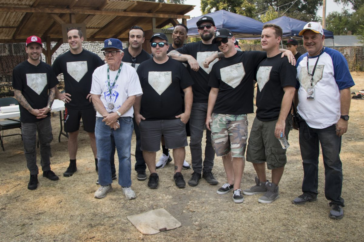 """Cast members of """"The Sandlot"""" pose for a photo with members of Utah's film groups at the Sandlot filming location in Salt Lake City on Saturday, Aug. 11, 2018. The movie turned 25 years ago this year."""