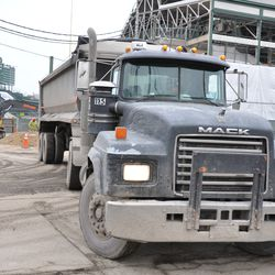 Another dump truck exiting the triangle lot