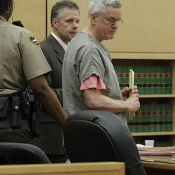 With his attorney Mark Quigley behind him, Steven Powell, right, is led from a courtroom shortly after being sentenced to 30 months in prison for voyeurism, June 15, 2012, in Tacoma, Wash. Diaries belonging to Powell, the father-in-law of missing mom Susan Powell, were released in Washington state Wednesday.