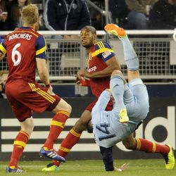 Sporting KC's Dom Dwyer is all contorted trying to kick a loose ball during a game at Sporting Park in Kansas City, Kan., on Saturday, April 5, 2014.