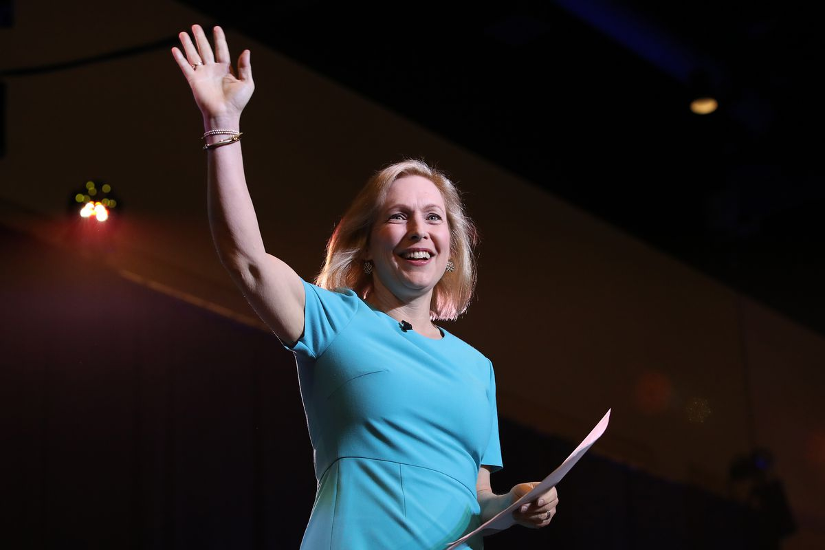 Kirsten Gillibrand waves from the stage at a campaign event.