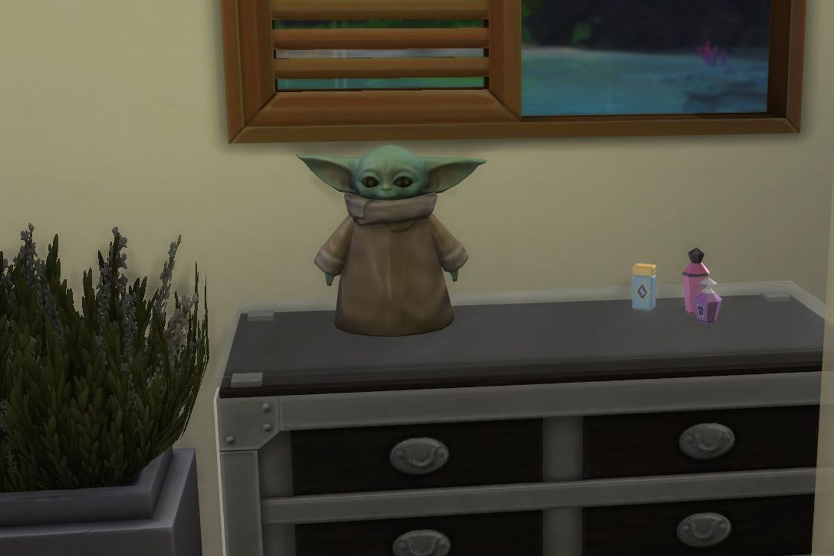 A Baby Yoda statue stands on a dresser in The Sims 4