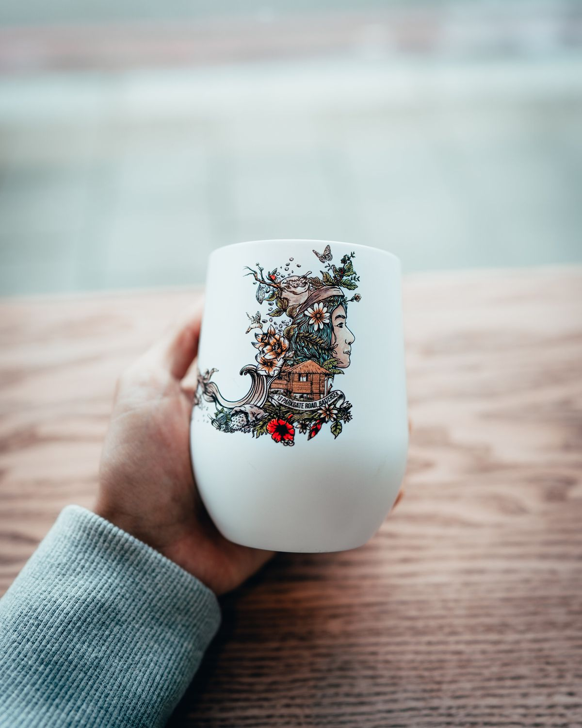 A coffee cup with Kapihan's illustration