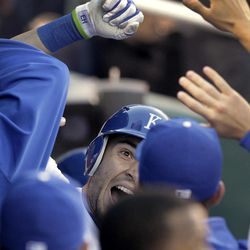Kansas City Royals' Eric Hosmer celebrates in the dugout after hitting a solo home run during the second inning of a baseball game against the Toronto Blue Jays on Monday, April 23, 2012, in Kansas City, Mo.