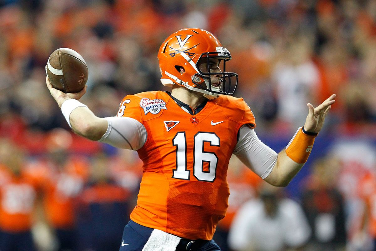Michael Rocco #16 of the Virginia Cavaliers stakes a firm claim to the color orange.  Just because new ACC member Syracuse is called the Orangemen doesn't mean that Virginia is willing to be out-oranged.  (Photo by Kevin C. Cox/Getty Images)