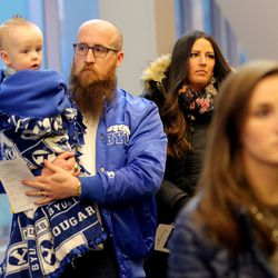 Jake and Lacy Andrus with their son, Hank, join with family, friends and former team members gathered to honor former BYU football coach LaVell Edwards at a memorial service at the Provo Convention Center on Friday, Jan. 6, 2017.