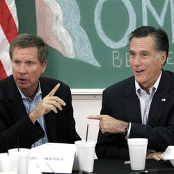 FILE - In this April 27, 2012 file photo, Republican presidential candidate, former Massachusetts Gov. Mitt Romney and Ohio Gov. John Kasich participate in a roundtable discussion in Westerville, Ohio. President Barack Obama and his supporters point to the U.S. auto comeback and a manufacturing rebirth. Kasich lauded his own policies in a speech at the GOP convention, noting he'd erased a projected $8 billion deficit without a statewide tax increase and Ohio has moved from 48th to 4th in job creation. His office says 122,500 jobs have been created since he took office in January 2011. (AP Photo/Jae C. Hong, File)