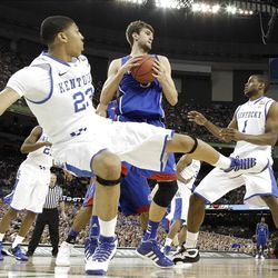 Kansas' Jeff Withey, center, grabs a rebound between Kentucky's Anthony Davis, left, and Darius Miller, right, during the first half of the NCAA Final Four tournament college basketball championship game Monday, April 2, 2012, in New Orleans. (AP Photo/David J. Phillip)