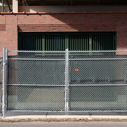 10:12 a.m. Gate Q, the knothole gate, locked up tight on Sheffield -