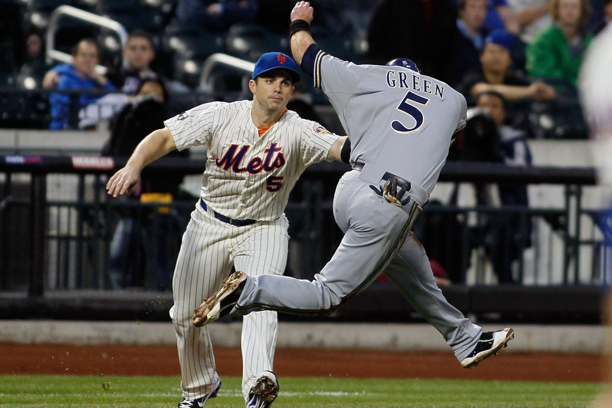 NEW YORK, NY - MAY 14:  David Wright #5 of the New York Mets tags out Taylor Green #5 of the Milwaukee Brewers at CitiField on May 14, 2012 in the Flushing neighborhood of the Queens borough of New York City.  (Photo by Mike Stobe/Getty Images)