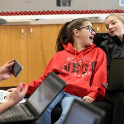 Arturo Martinez, 13, Katherine Berensen, 13, and Stella Bradley, 13, left to right, hang out and study in the Our CASA space at West High School in Salt Lake City on Friday, Feb. 24, 2017. Our CASA spaces are part of an initiative to increase access to higher education for first-generation students and their families on Salt Lake City's west side. The students are part of the Extended Learning Program that allows middle schoolers to take high school courses.