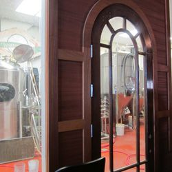 The now enclosed production side of the brewery. Glass windows and doors allow guests to view brewers at work.