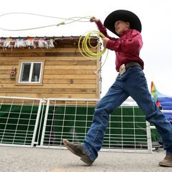 Wyatt Rindlisbacher competes in a roping contest between sessions of the Utah High School Rodeo Finals at the Wasatch County Events Complex in Heber City on Thursday, June 1, 2017.