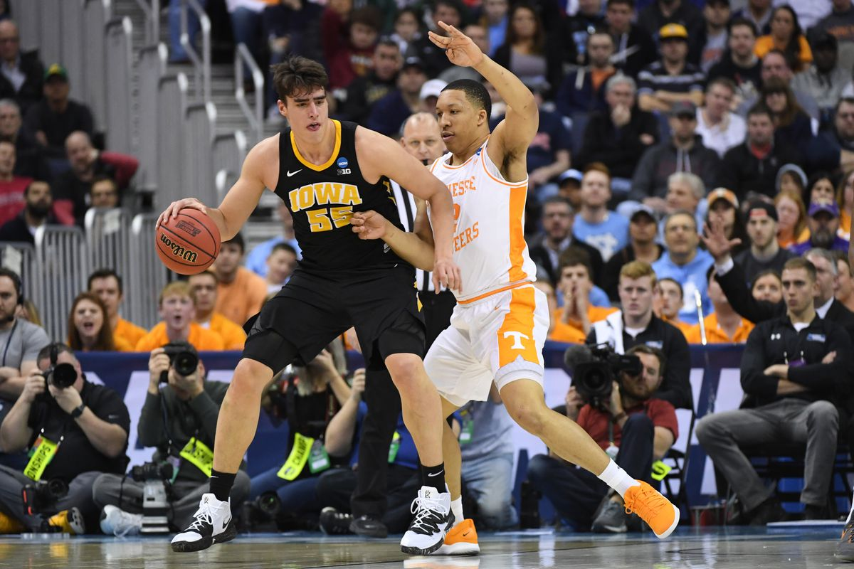 Luka Garza of the Iowa Hawkeyes posts up against Grant Williams of the Tennessee Volunteers in the second round of the 2019 NCAA Photos via Getty Images Men's Basketball Tournament held at Nationwide Arena on March 24, 2019 in Columbus, Ohio.