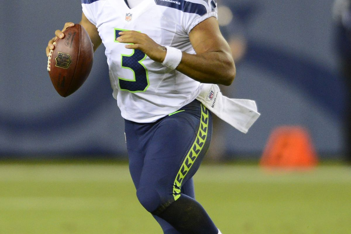 August 18 2012; Denver, CO, USA; Seattle Seahawks quarterback Russell Wilson (3) scrambles in the fourth quarter of a preseason game against the Denver Broncos at Sports Authority Field. Mandatory Credit: Ron Chenoy-US PRESSWIRE