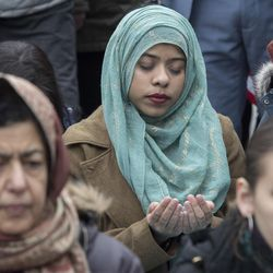 Taslima Choudhury, center, of the Queens borough of New York, prays during Jummah, a Muslim Friday prayer service, in Foley Square, Friday, Jan. 27, 2017, in New York. The rally and prayer service sponsored by the New York Immigration Coalition and the Inter-Faith Clergy of New York City was in support of Muslims and immigrants.