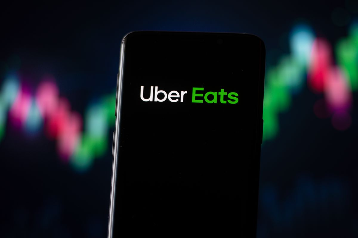 In this photo illustration an Uber Eats logo seen displayed...
