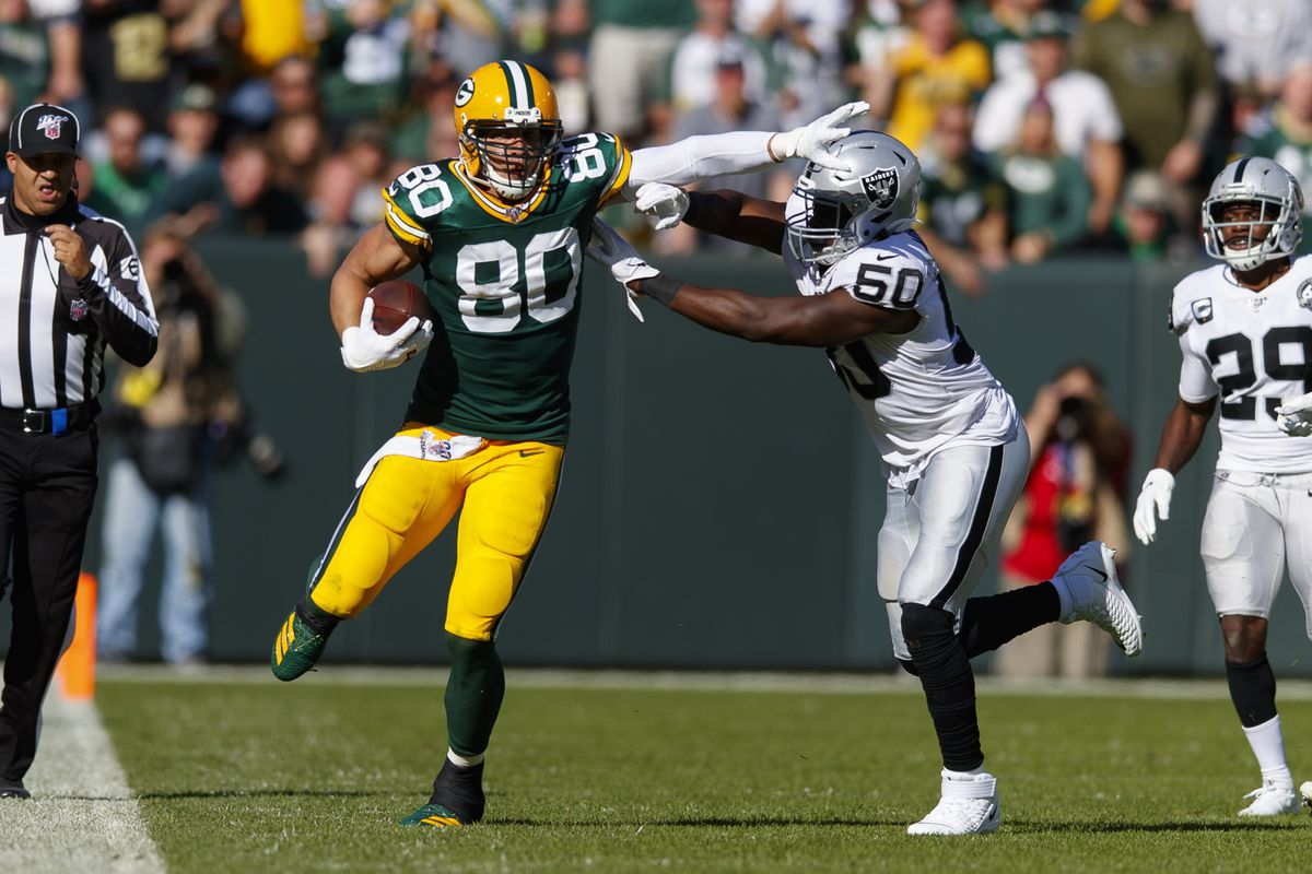 Green Bay Packers tight end Jimmy Graham stiff arms Oakland Raiders linebacker Nicholas Morrow after catching a pass during the third quarter at Lambeau Field.