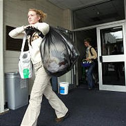 Lindsey Evans, a member of the BYU women's volleyball team, carries out her locker items from the Smith Fieldhouse on Monday.