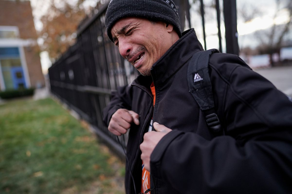 Richard Adams, 47, becomes emotional as he recounts his experiences with homelessness and addiction while talking with journalists outside Catholic Community Services' Weigand Center in Salt Lake City on Thursday, Nov. 21, 2019.