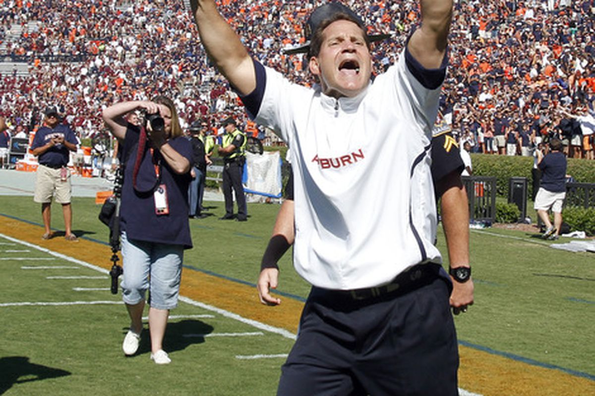 AUBURN, AL - SEPTEMBER 10:  Coach Gene Chizik of the Auburn Tigers celebrates the 41-34 win over the Mississippi State Bulldogs after the game on September 10, 2011 at Jordan-Hare Stadium in Auburn, Alabama. (Photo by Butch Dill/Getty Images)
