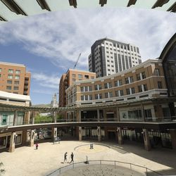 A few people walk through City Creek Center in Salt Lake City on Wednesday, May 6, 2020. The shopping center reopened Wednesday.
