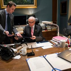 Sen. Orrin Hatch, R-Utah, prepares to sign a bill in his office in the Hart Senate Office Building in Washington, D.C., on Thursday, Jan. 19, 2017. The bill, being presented by Ryan Leavitt, left, a counsel in the president pro-tempore's office, provides a waiver allowing James Mattis to serve as secretary of defense despite not being out of the military for the seven years required for that job. It is expected to be the first bill signed by President Donald Trump after his inauguration.