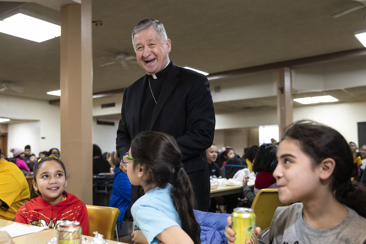 Archdiocese of Chicago Cardinal Blase Cupich speaks with students and families during lunch at St. Genevieve Catholic School, 4854 W. Montana St., Thursday, Jan. 30, 2020.