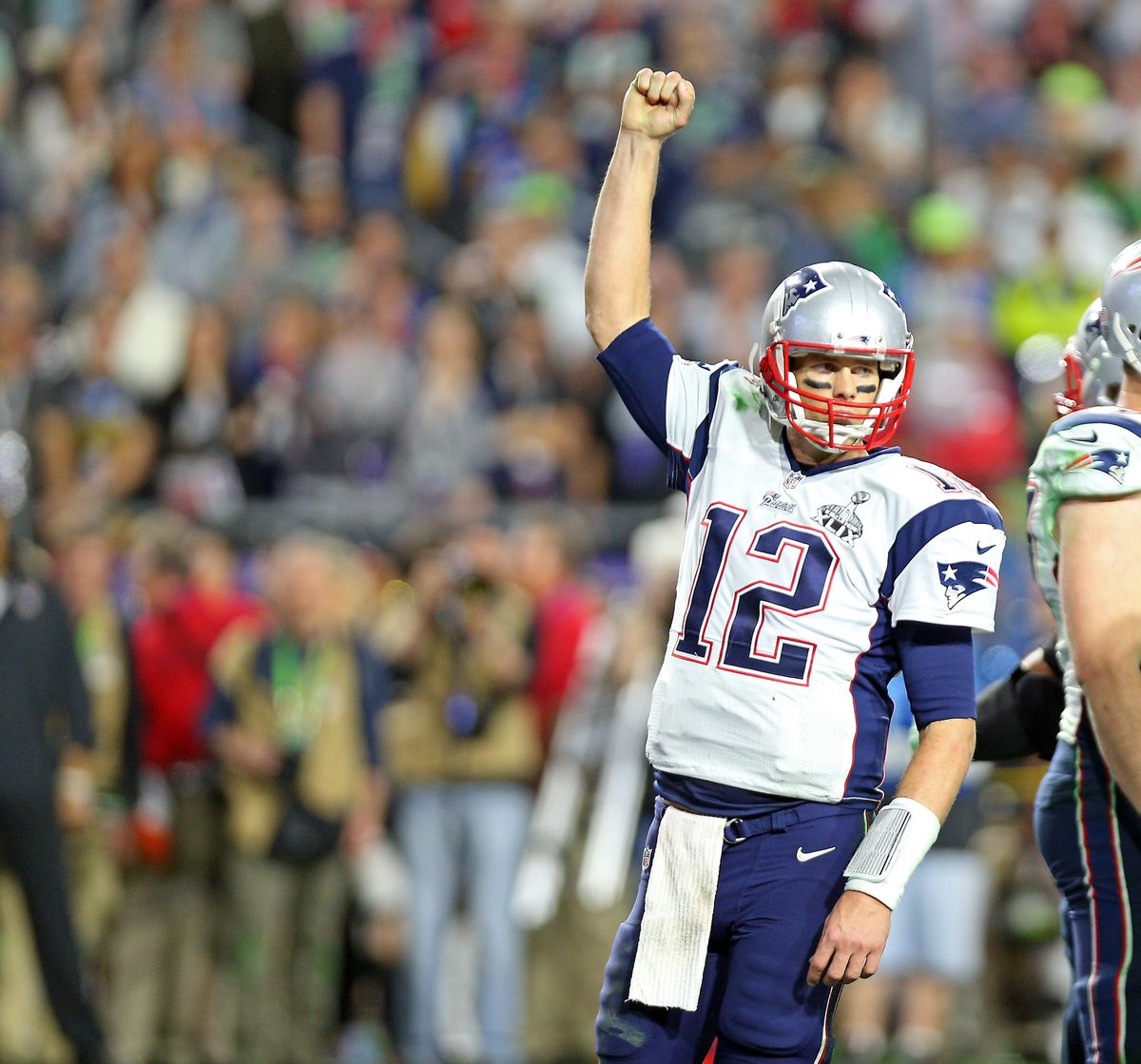 (020215 Glendale, AZ) New England Patriots quarterback Tom Brady signals the win at the end of the game as the New England Patriots take on the Seattle Seahawks in Super Bowl XLIX in Glendale, AZ. (Monday,February 2, 2015). Staff Photo by Nancy Lan