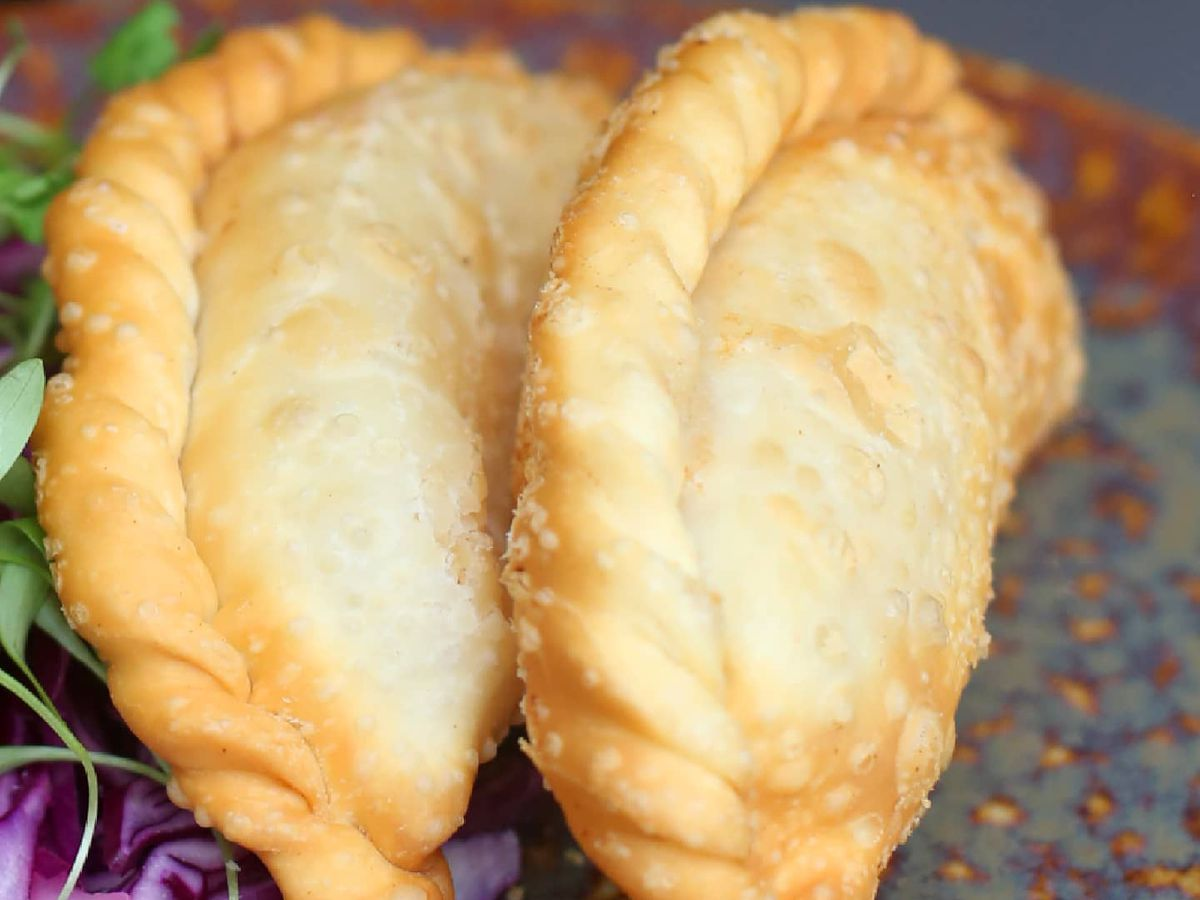 Two perfectly baked ham and cheese empanadas from El Vinedo Local  in Midtown Atlanta
