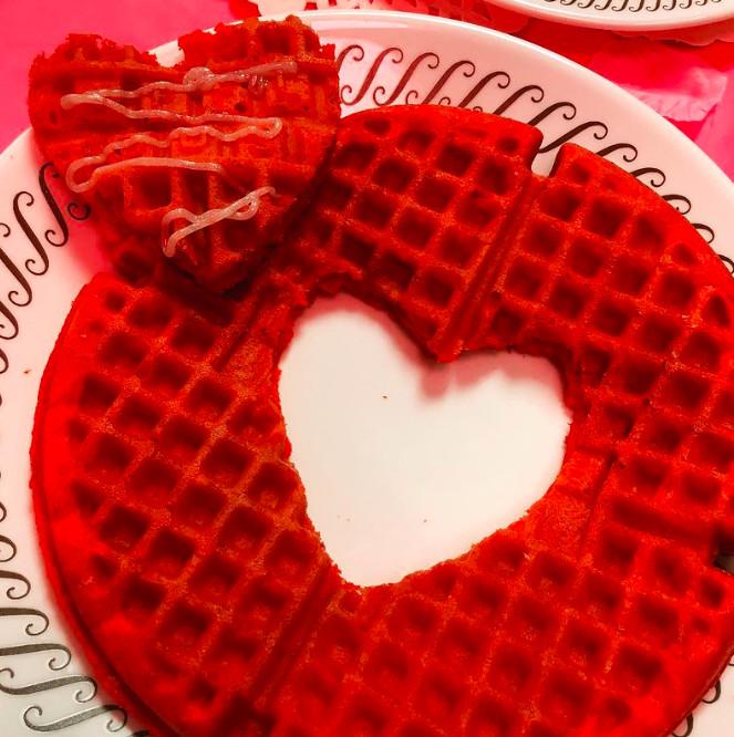 A red heart shaped waffle at waffle house on cheshire bridge road in atlanta