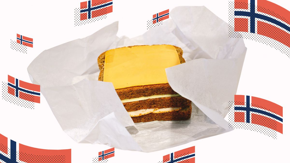 A Norwegian matpakke surrounded by many waving Norwegian flags.