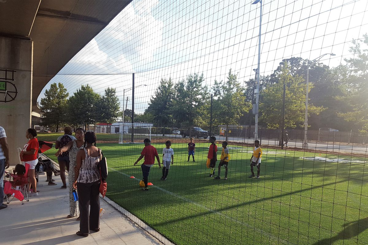 a picture of kids playing at the Station Soccer fields