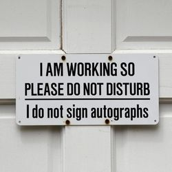 A sign on door bids visitors to not disturb is seen during a preview tour of the home and studio of artist Andrew Wyeth Monday, April 23, 2012 in Chadd's Ford, Pa. The studio will be open for tours in the summer of 2012 by the Brandywine River Museum.